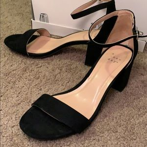 Black strap open toed shoes